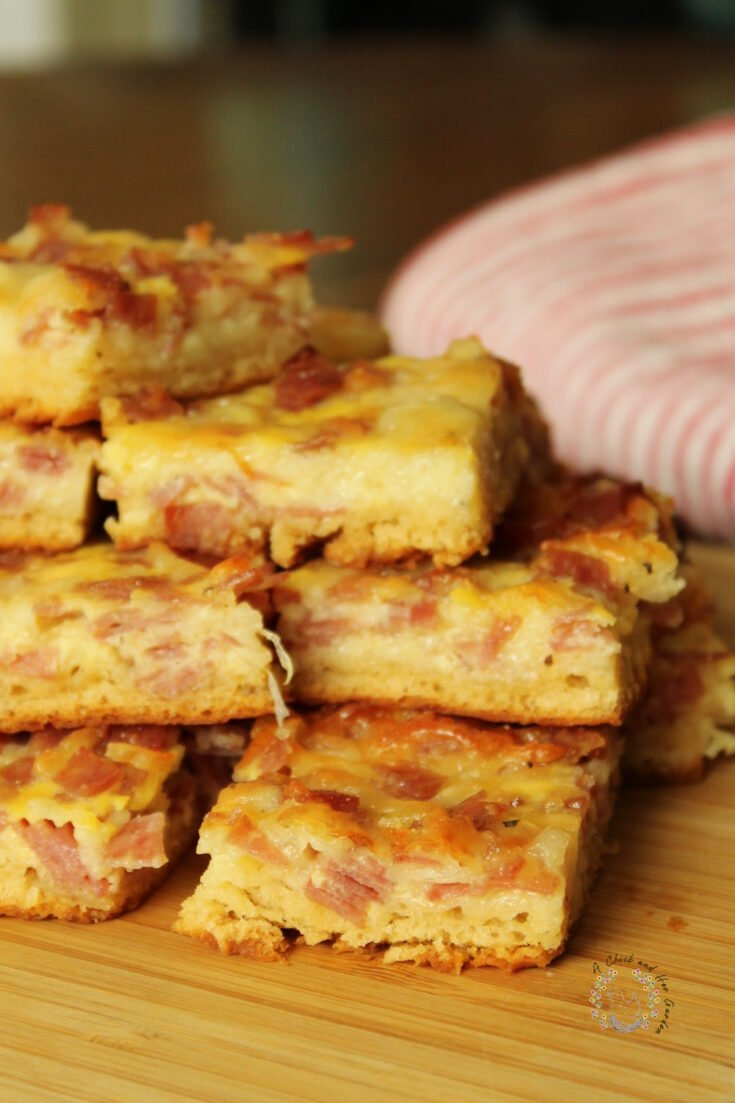 salami squares stacked on a bamboo tray