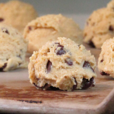 chocolate chip cookie dough balls on a stone cookie sheet