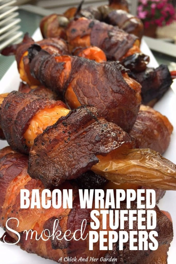 My husband loves any excuse to use his smoker to cook! And this recipe for bacon wrapped smoked stuffed peppers has to be one of his new favorites! I find him making them outside when it's snowing he loves them so much! They're a great snack for game day! #superbowlsnacks #partysnacks #appetizers #smokerrecipes #stuffedpeppers #gamedayfood #achickandhergarden