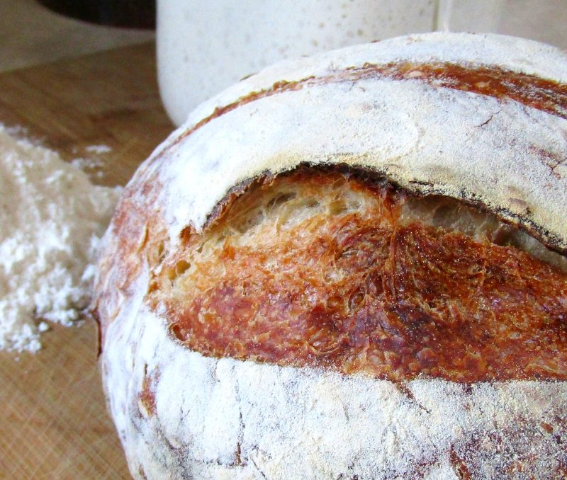 This bread is amazing! Artisan Sourdough bread is something I never thought I could make myself, but after following her recipe I make it all the time! #breadrecipes #artisansourdoughbread #sourdoughbread #sourdoughrecipes #fromscratchbaking #achickandhergarden