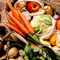 carrots apples lemons mushrooms cabbage in a basket